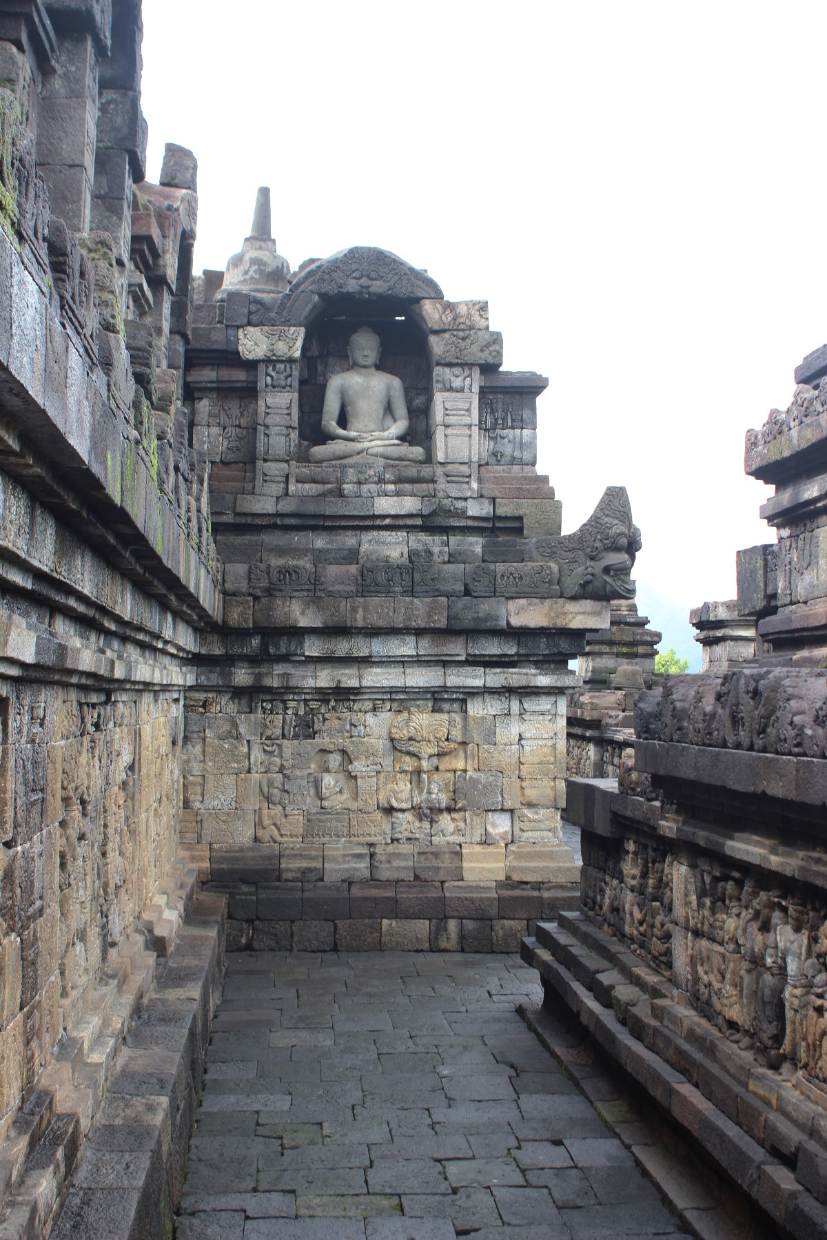 Buddha statue and sculpted walls