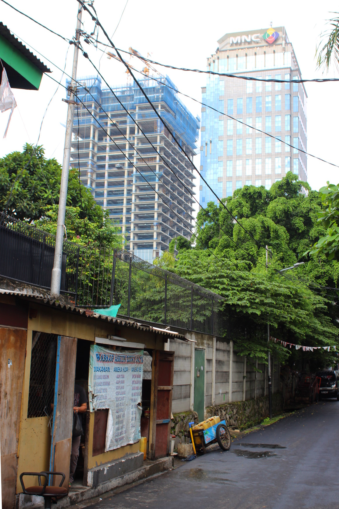 Jakarta buildings and a small house