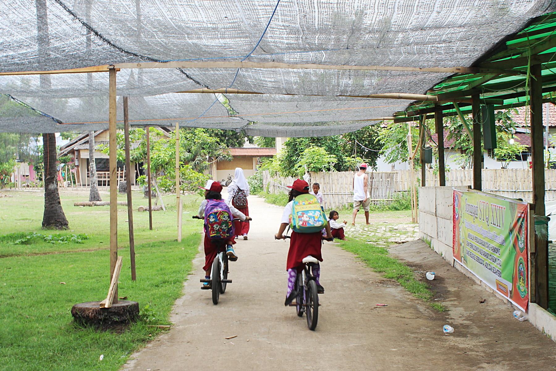 Childer riding bikes