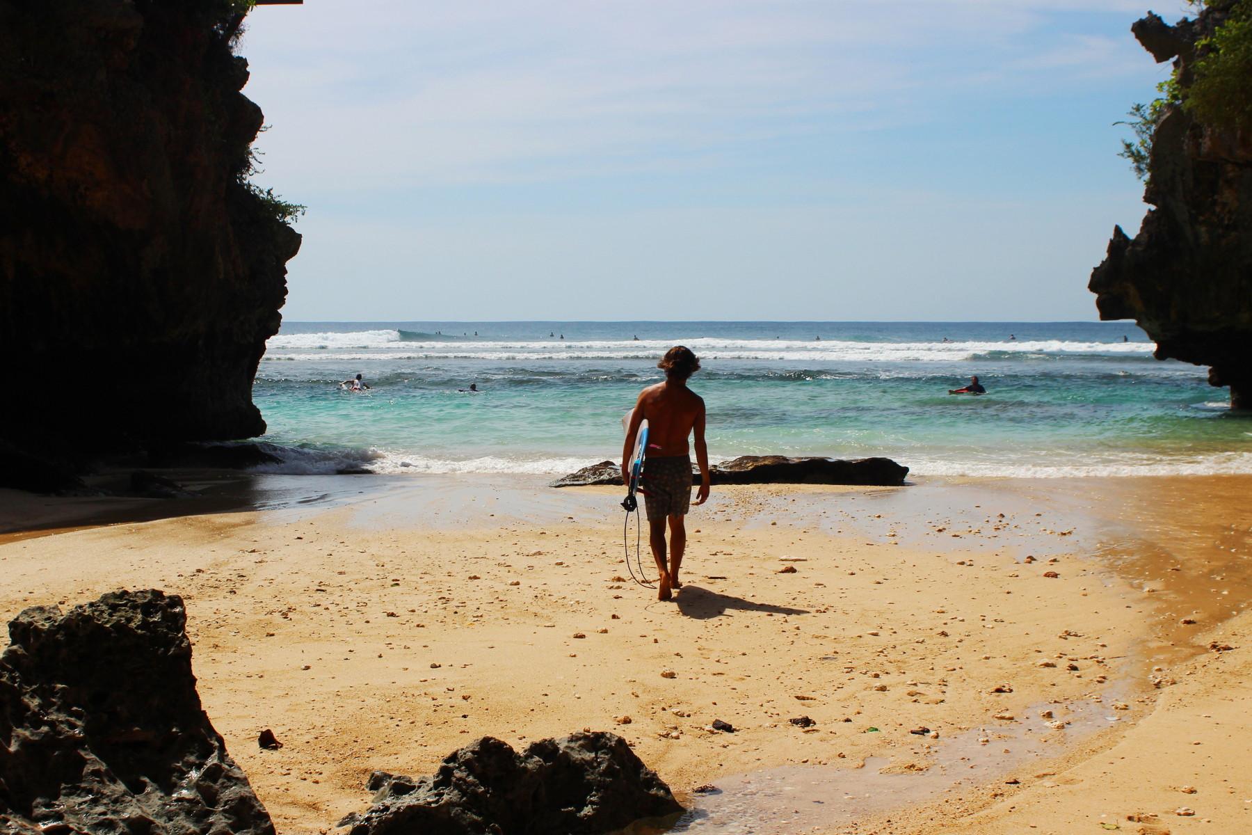 Surfer entering the sea