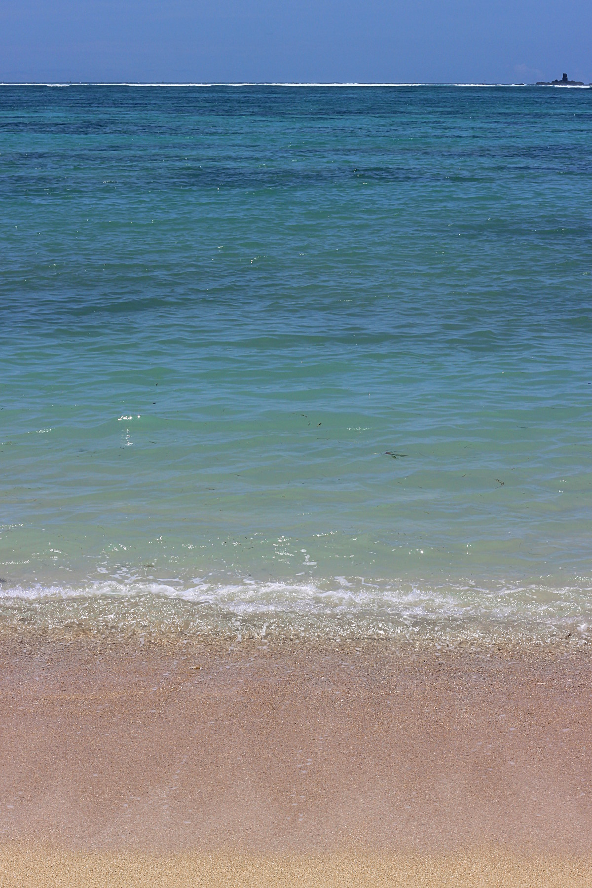 Pink sand and blue sea