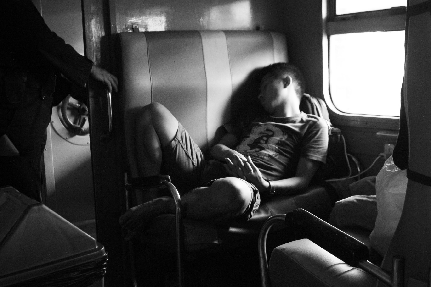 A man sleeping in the train