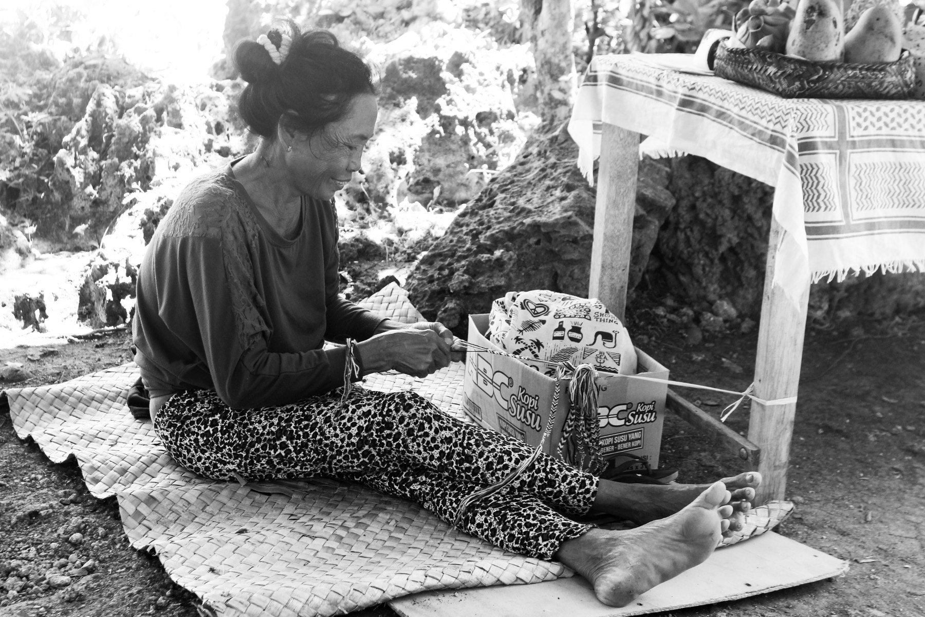 A girl making bracelet.